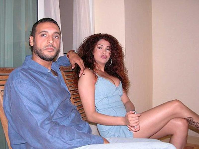 An undated picture allegedly found in the personal laptop of Hannibal Gaddafi, son of Muammar Gaddafi, and released by Libyan National Transitional Council fighters shows him and his Lebanese wife Aline Skaff at an unknown location in Libya.