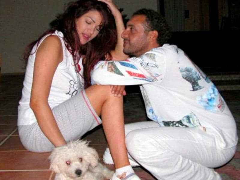 An undated picture allegedly found in the personal laptop of Hannibal Gaddafi, son of Muammar Gaddafi, and released by Libyan National Transitional Council fighters shows him and his Lebanese wife Aline Skaff at their house in Tripoli.