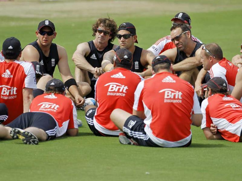 England's players and team members sit in a group before a practice session ahead of their first one-day international cricket match against India in Hyderabad.
