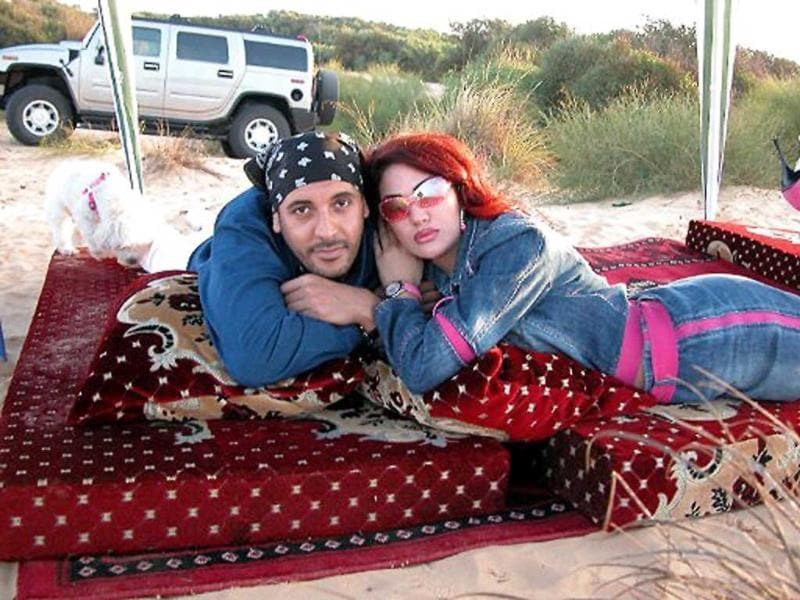 An undated picture allegedly found in the personal laptop of Hannibal Gaddafi, son of Muammar Gaddafi, and released by Libyan National Transitional Council fighters shows him and his Lebanese wife Aline Skaff on a picnic trip in Libya.