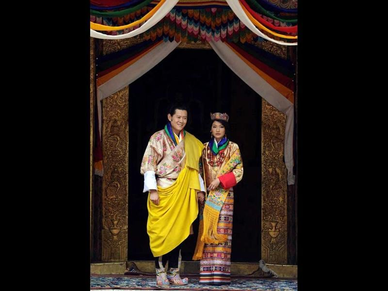 King of Bhutan Jigme Khesar Namgyel Wangchuck (L) and newly crowned Queen of Bhutan Jetsun Pema (R) pose after their marriage ceremony at the Dzong monastery in Punakha, Bhutan.