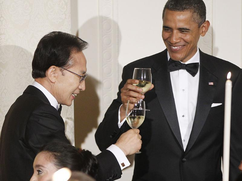 President Barack Obama offers a toast during a State Dinner with South Korean President Lee Myung-bak in the East Room at the White House in Washington.