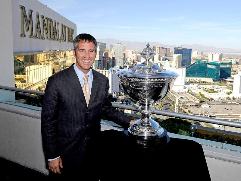 IndyCar CEO Randy Bernard poses with the new IndyCar Series world championship trophy during a photo opportunity at the House of Blues Foundation Room inside the Mandalay Bay Resort in Las Vegas, Nevada.
