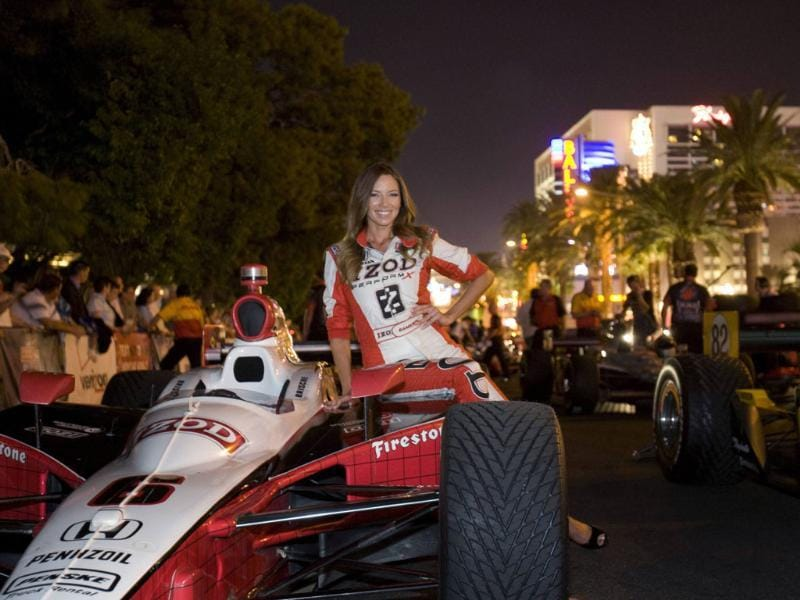 IZOD IndyCar Series Trophy Girl Cameron Haven poses before driver introductions in front of the Bellagio Resort and Casino on the Las Vegas Strip in Las Vegas, Nevada.