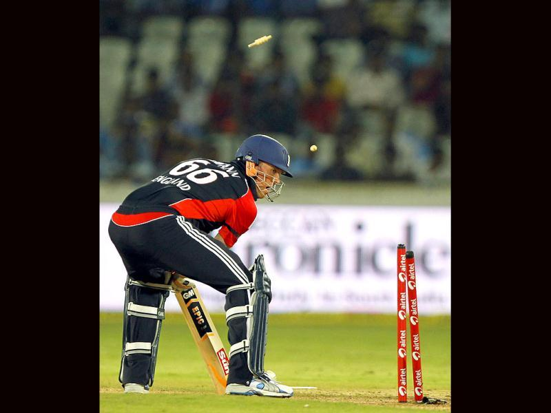 England player Graeme Swann was bowled by Indian player Umesh Yadav during the 1st One Day International between England and India at The Rajiv Gandhi International Cricket Stadium in Hyderabad.