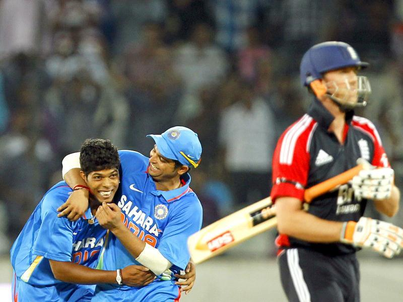 Umesh Yadav celebrates with team-mates after taking the wicket of England player Graeme Swann during the 1st One Day International between England and India.