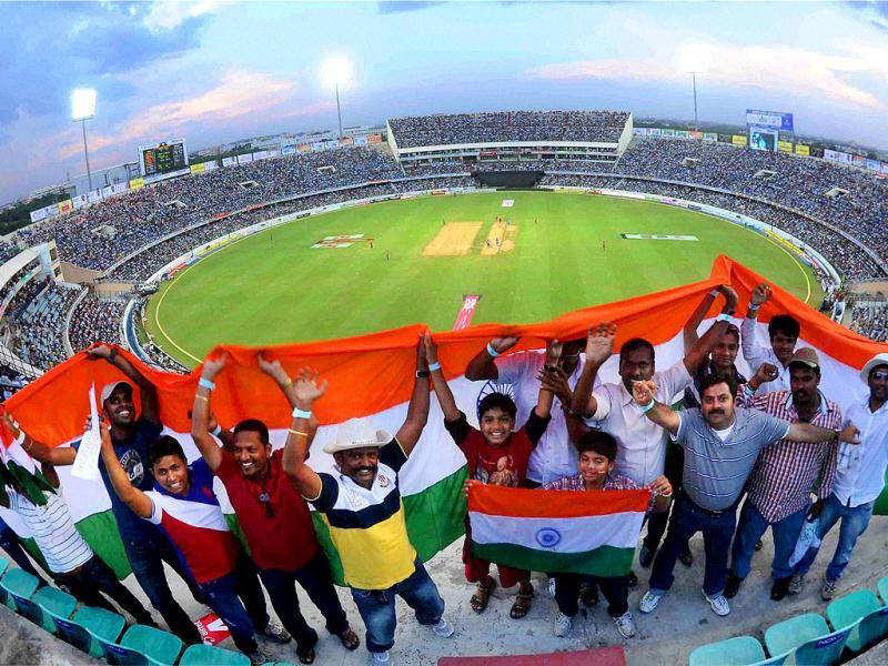 Cricket fans celebrate during the ODI match between India and England in Hyderabad.