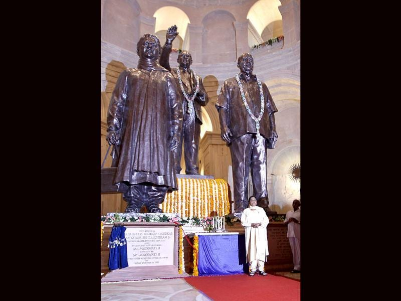 Uttar Pradesh chief minister Mayawati (bottom right) stands near statues of herself (L) Bhimrao Ramji Ambedkar (C) and Bahujan Samaj Party leader Kansi Ram in a hall at a newly inaugurated park in Noida. (Photo: AP Photo)