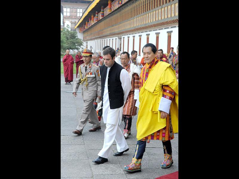 Indian MP Rahul Gandhi walks with former Bhutan King Jigme Sinagye Wangchuk during a ceremony for the newly wed Bhutanese royal couple in Thimphu.