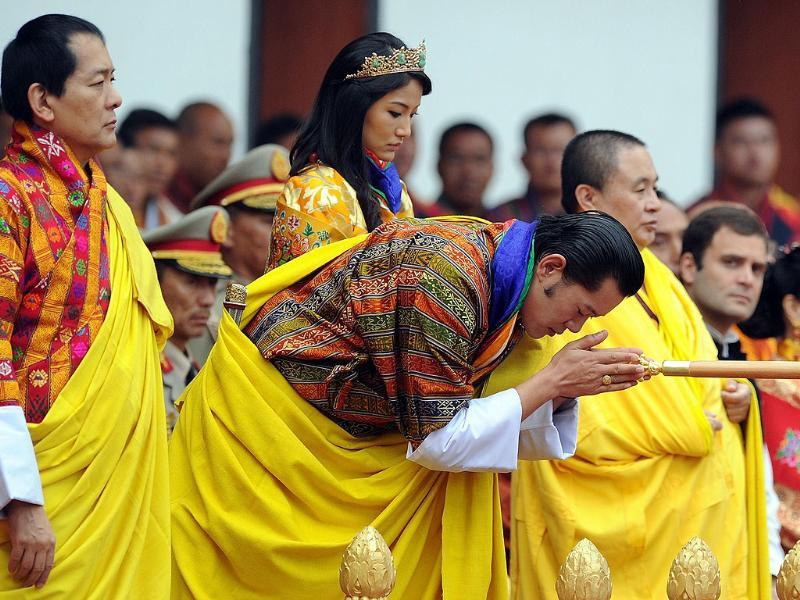 Former Bhutan King Jigme Sinagye Wangchuk and Rahul Gandhi watch as Bhutanese royal couple perform rituals during a ceremony in Thimphu.
