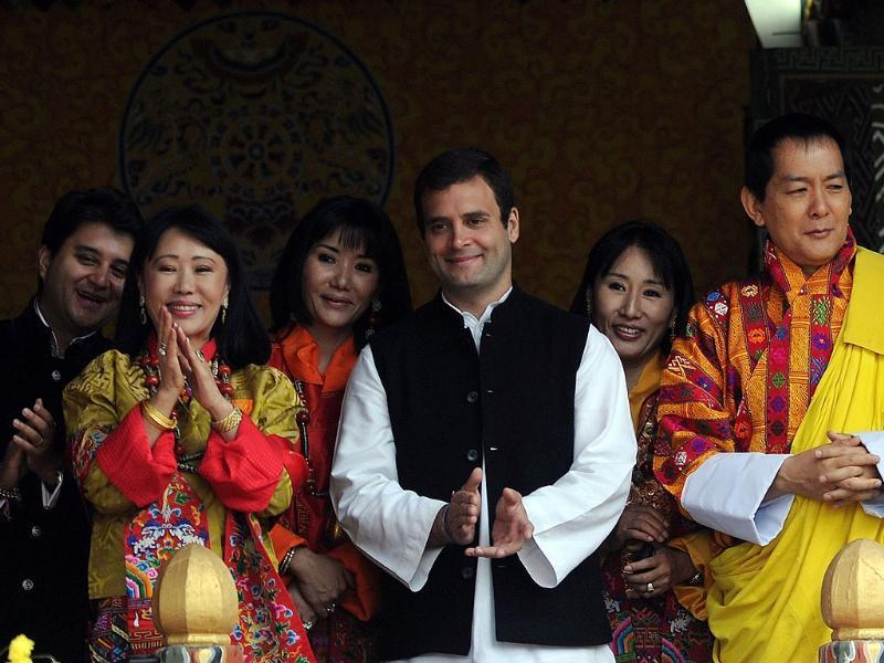 Former Bhutan King Jigme Sinagye Wangchuk with his queens, Rahul Gandhi and Jyotiraditya Madhavrao Scindia applaud the crowd during a ceremony at the main stadium in Thimphu.