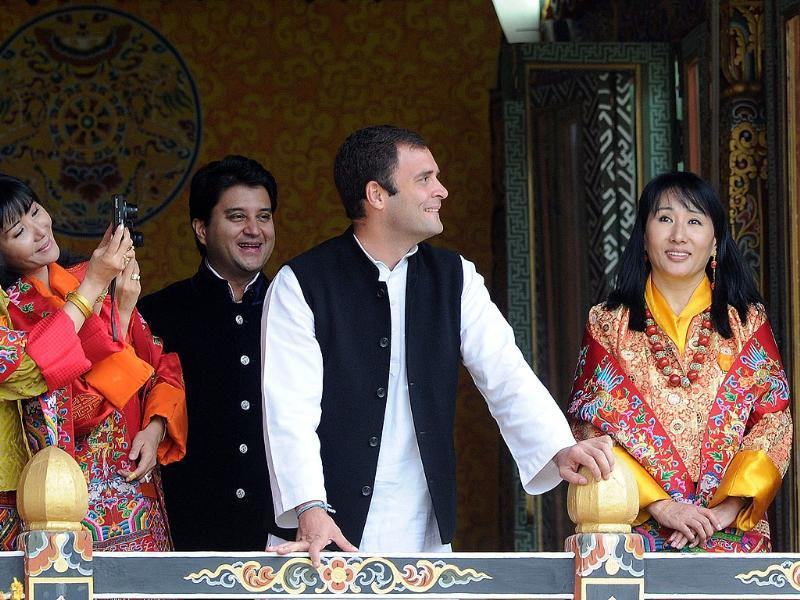 MP Rahul Gandhi and Jyotiraditya Madhavrao Scindia react as queens of former Bhutan King Jigme Sinagye Wangchuk take photographs during a ceremony for the newly wed Bhutanese couple at the main stadium in Thimphu in Bhutan.