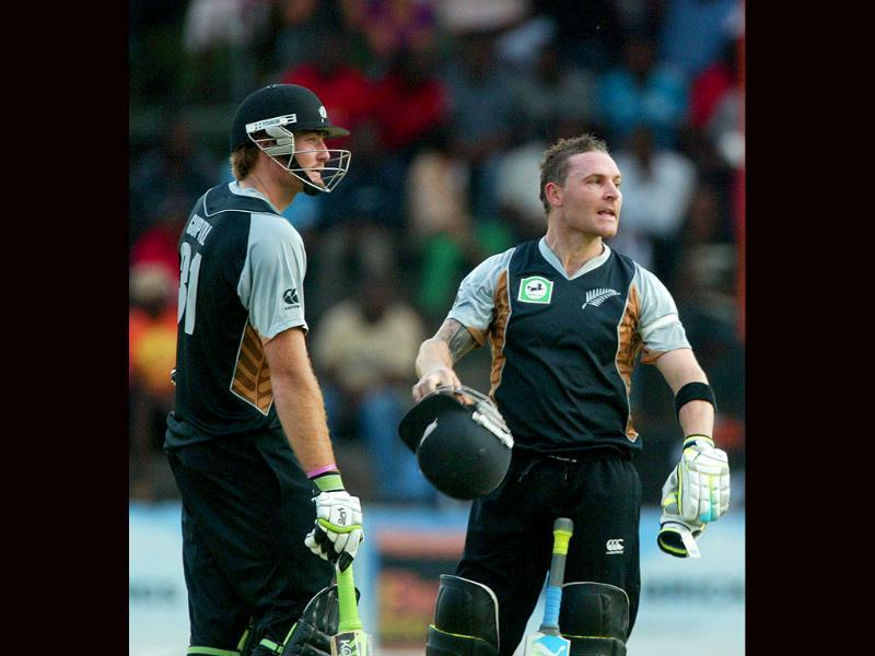 Brendon McCullum and Martin Guptill (L) of New Zealand look on after their innings during the first match of their two match T20 series versus Zimbabwe in Harare. New Zealand won by 10 wickets. (Photo: AFP)