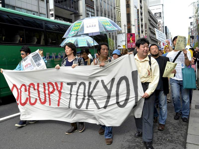 Demonstrators hold up a banner during a rally inspired by the Occupy Wall Street protest in Tokyo.