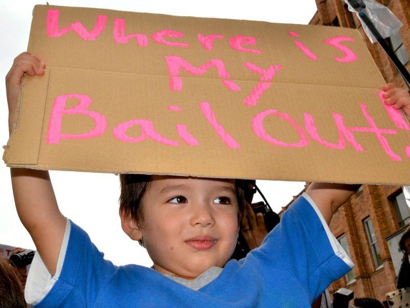A child holds up a placard during a worldwide protest inspired by the Occupy Wall Street protest in Tokyo.