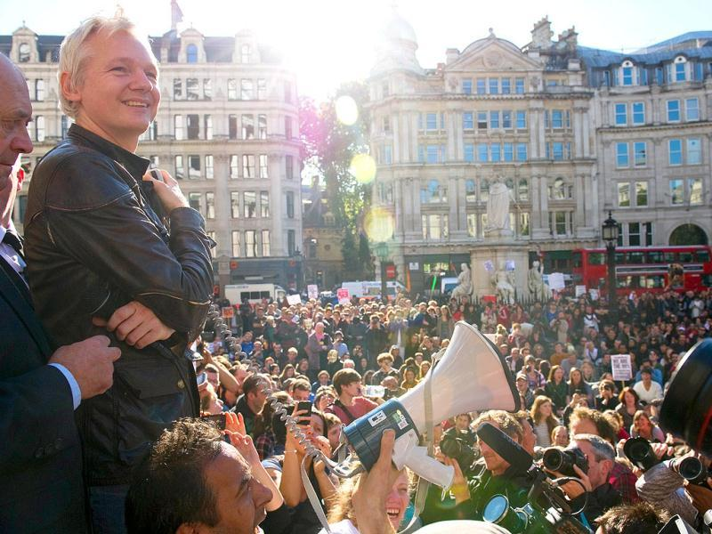 Wikileaks founder Julian Assange speaks to demonstrators from the steps of Saint Paul's Cathedral in central London during Occupy London protests.
