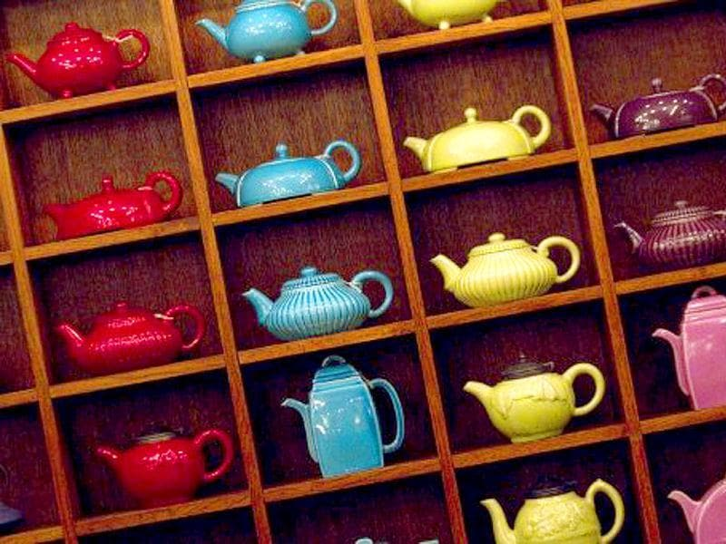 Picture showing tea pots at the French luxury Tea House, Mariage Freres,Louvre gallery, under the Louvre Pyramid, central Paris.