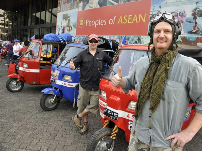 Singapore residents Dan Fidock (R) and Daniel Vanhaeff (L) pose in front of their auto-rickshaw during the send-off ceremony in Jakarta.