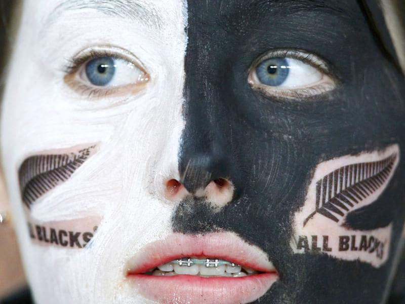 A fan of New Zealand All Blacks looks on before the team's Rugby World Cup semi-final match against Australia Wallabies at Eden Park in Auckland.
