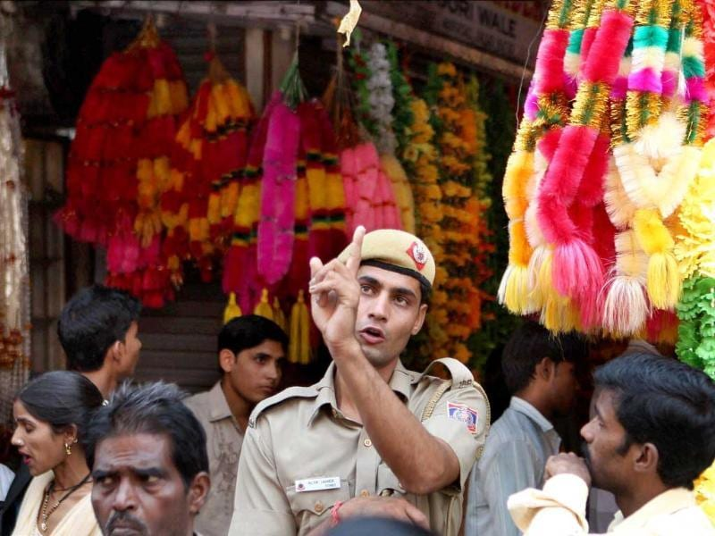 A Delhi police personal keep Vigil in Sadar Bazar Market, ahead of Diwali festiva in Delhi.
