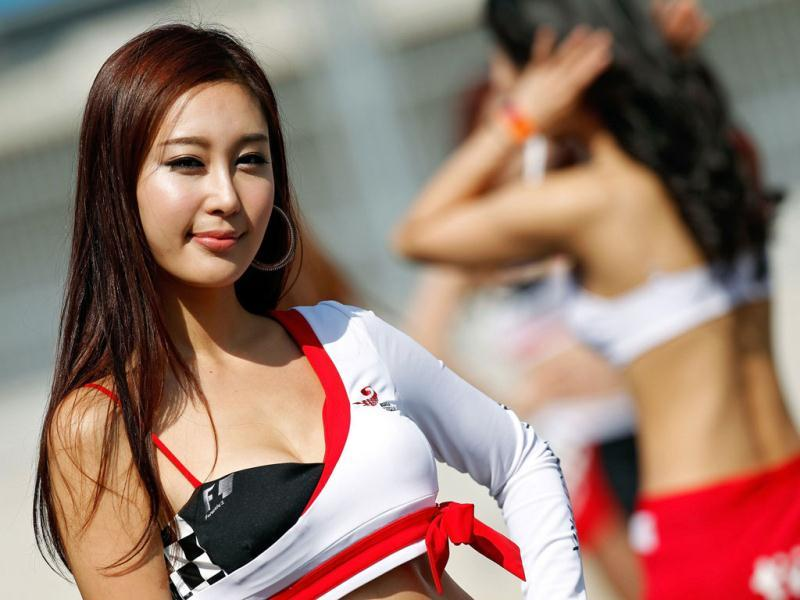Grid girls pose on the circuit prior to the start of the Formula One Korean Grand Prix in Yeongam.