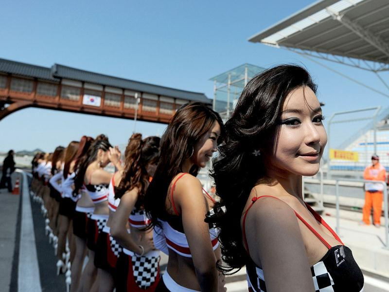 Grid girls pose on the circuit ahead of the start of the Formula One Korean Grand Prix in Yeongam.