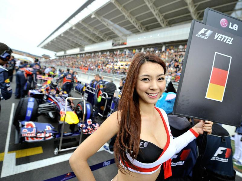 A South Korean model poses on the starting grid position of Red Bull-Renault driver Sebastian Vettel of Germany prior to the start of the Formula One Korean Grand Prix in Yeongam.