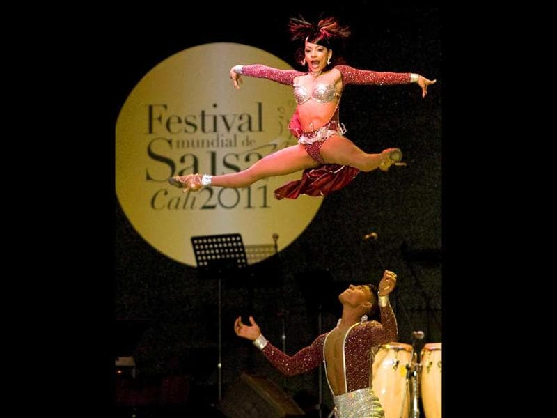 Colombian dancer Marcela Orozco (Top) and Fernando Hernandez perform during the cabaret couple category of the 6th World Salsa Festival at the Cañaveralejo Bullring, in Cali, Valle del Cauca department, Colombia.