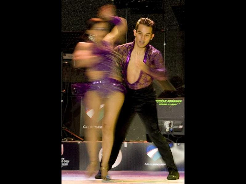 Colombian dancers Fredy Ospina (R) and Claudia Garzon perform during the cabaret couples category of the 6th World Salsa Festival at the Cañaveralejo Bullring, in Cali, Valle del Cauca department, Colombia.