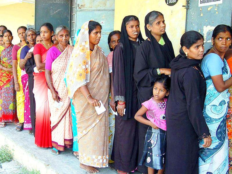 Women lining up in front of a polling station to cast their votes for local body elections, in Chennai.