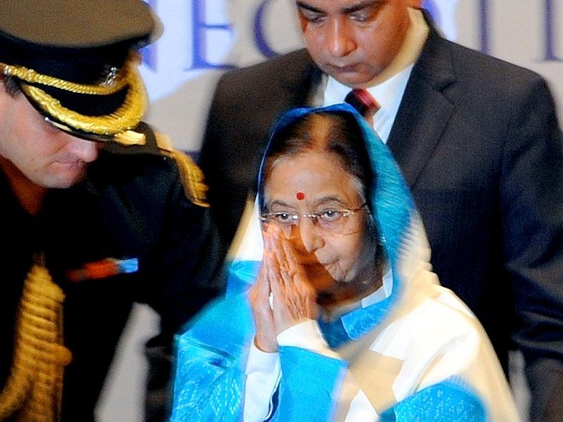 Indian President Pratibha Patil gestures as she prepares to leave after attending the 4th International Civil Aviation Negotiation Conference in Mumbai