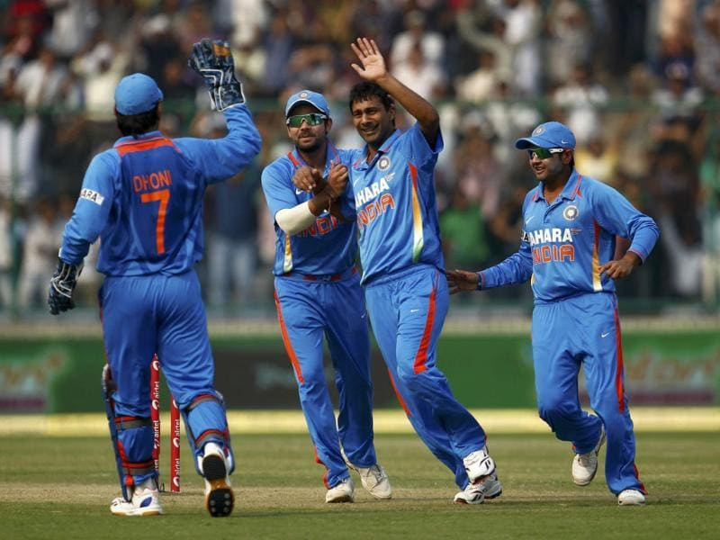 Vinay Kumar celebrates with teammates after dismissing England's captain Alastair Cook during their second one-day international cricket match in New Delhi.