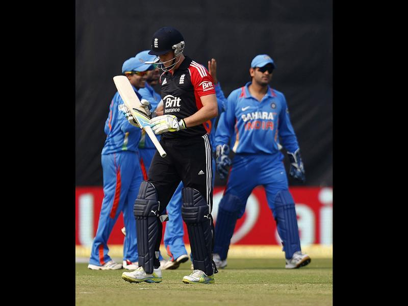Craig Kieswetter walks back to the pavilion after being dismissed by Vinay Kumar during their second one-day international cricket match in New Delhi.