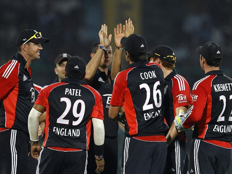 England's bowler Tim Bresnan celebrates with teammates the dismissal of Parthiv Patel, not seen, during their second one-day international cricket match in New Delhi.
