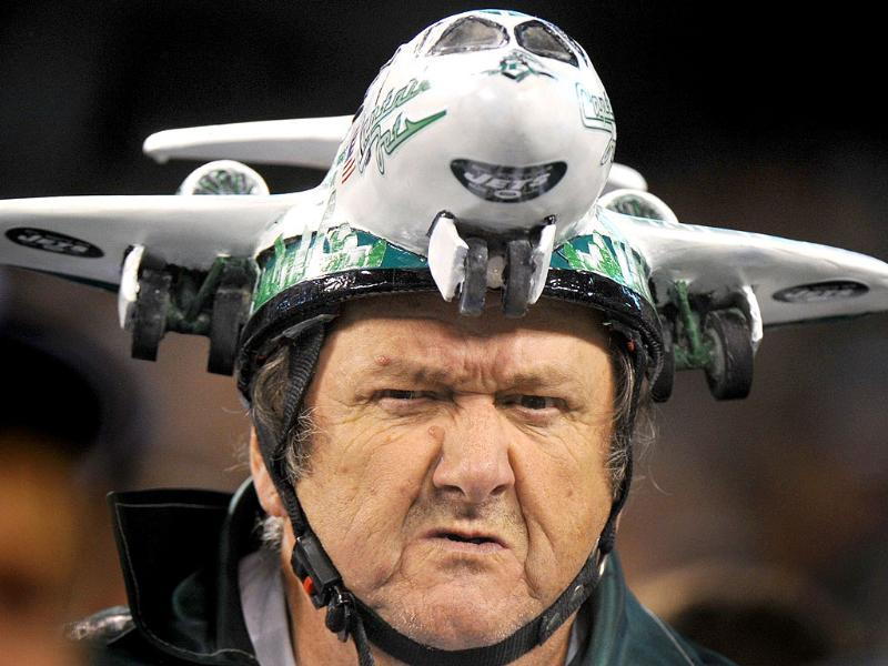 A New York Jets fan wears a hat shaped in the form of a jet in the stands during the NFL football game against the Miami Dolphins in East Rutherford, New Jersey.