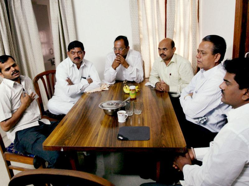 Sarpanch of Anna Hazare's village Ralegan Siddhi, Jaisingh Sadashiv Mapari (2nd from left) and his team members at the residence of Kerala MP, P T Thomas in New Delhi.