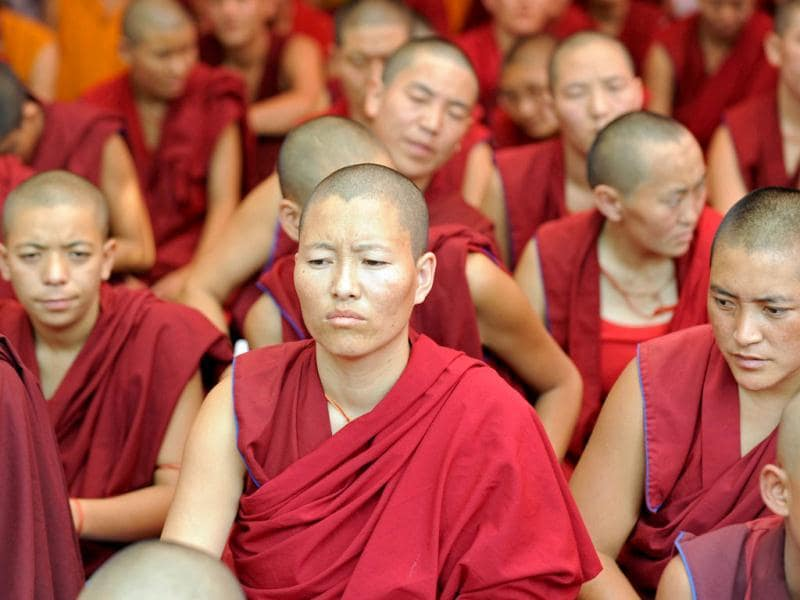 Tibetan Buddhist monks and nuns participate in a sit-in solidarity rally against China's rule on Tibet, in New Delhi.