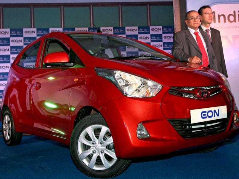 Senior Vice-President, Hyundai Motors India Limited, R Sethuraman (L) and Zonal Head, J E Lee during the launch of the company's new EON car in Kolkata.