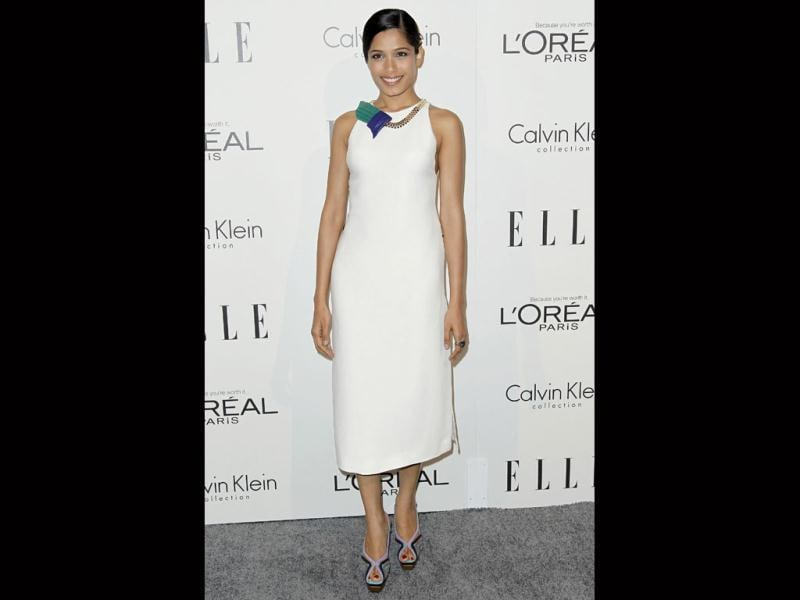 Freida Pinto looks a plain Jane in a boring flattened hairdo and matronly dress. (AP)