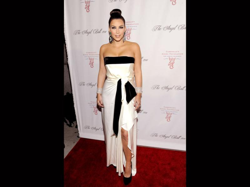 Kim Kardashian reminds one a bit of a Samurai with that really tightly pulled back hairdo. The dress, however, tells a different story. (AP)