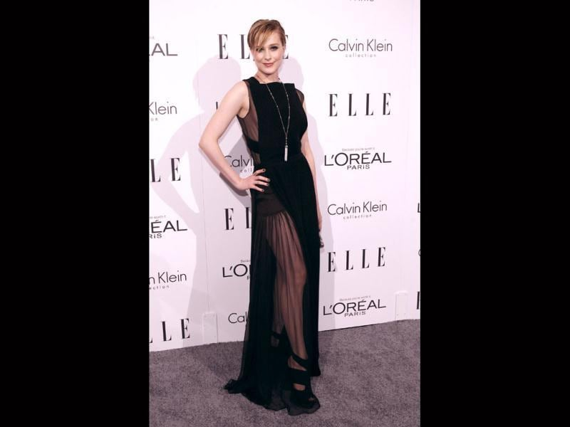 Evan Rachel Wood's see-through evening gown contrasts well with her fair skin. (AP)