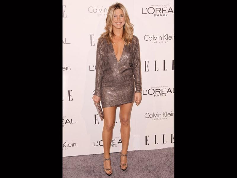 Jennifer Aniston looks absolutely wow as she shows off her perfect body in a short shimmery steel grey dress. (AP)