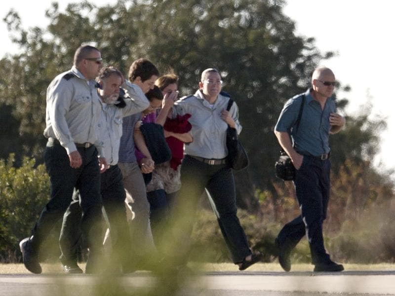 Noam Schalit (R) and Aviva Schalit (3R) parents of Israeli captured soldier Gilad Schalit walk together with their son Yoel (5R) and his girlfriend Yaara Winkler (4R) along with Israeli army officers towards an Army helicopter (not seen) in Tefen, northern Israel.