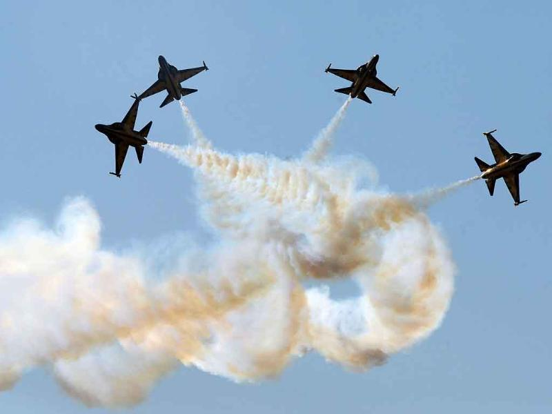 The Black Eagles, an aerobatic team of T-50 jets belonging to South Korea's Air Force, fly in formation during the opening of the Seoul International Aerospace and Defense Exhibition 2011 at the Seoul Military Airport in Seongnam.