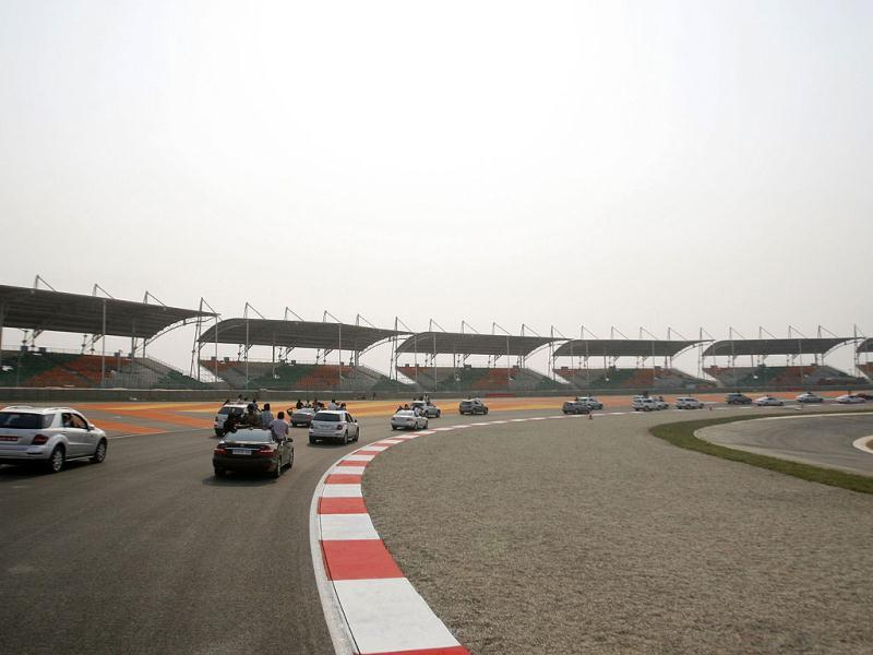 A convoy of cars drive around the track at the Buddh International Circuit, the venue for the first ever Indian F1 race at Greater Noida.