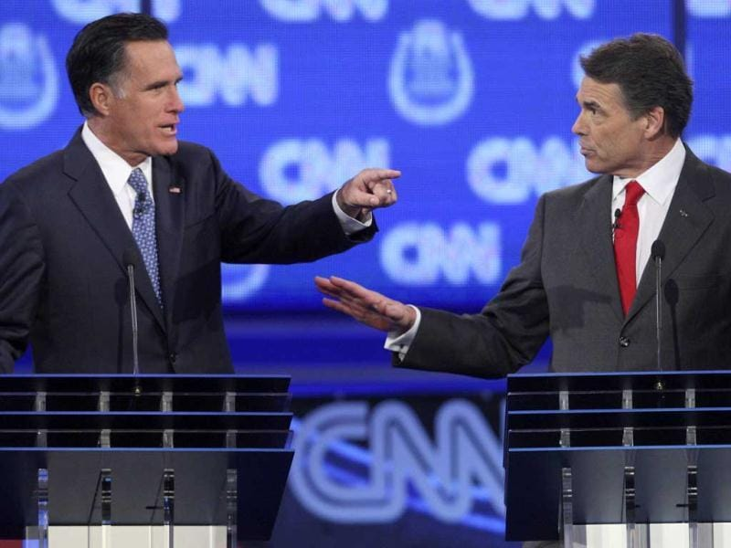 GOP presidential candidates former Massachusetts governor Mitt Romney (L) and Texas governor Rick Perry debate illegal immigration as they take part in the CNN Western Republican debate in Las Vegas.