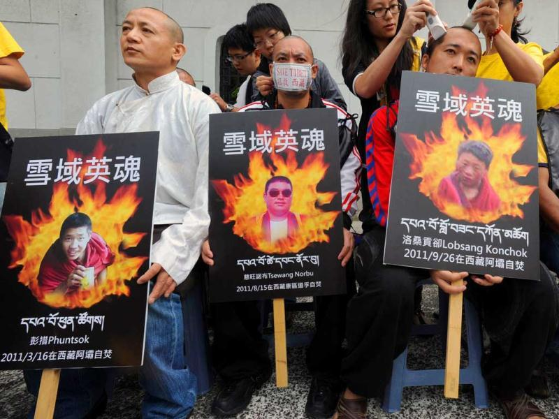 Tibetans have their hair cut during a protest to support the independence of Tibet in front of the Liberty Square in Taipei.
