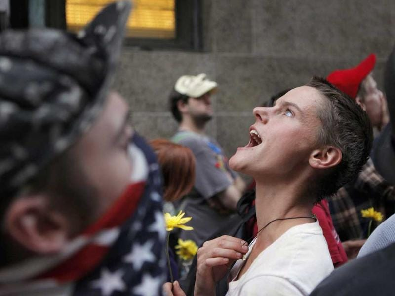 A member of the Occupy Wall Street movement chants outside the office of Manhattan District Attorney Cyrus R Vance Jr in New York.