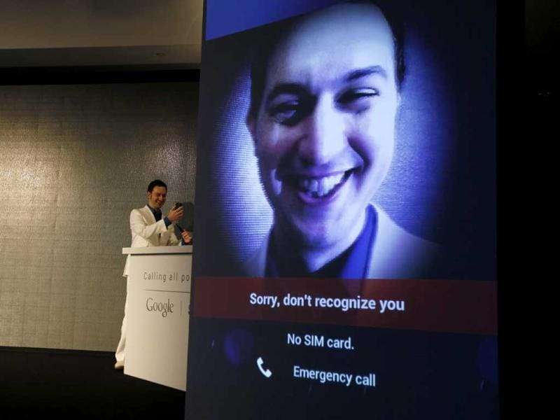 Matias Duarte, senior director of Android User Experience at Google, holding the new Galaxy Nexus smartphone, tries to demonstrate the Face Unlock feature to activate the Galaxy Nexus, the first to use the Google Ice Cream Sandwich Android OS.