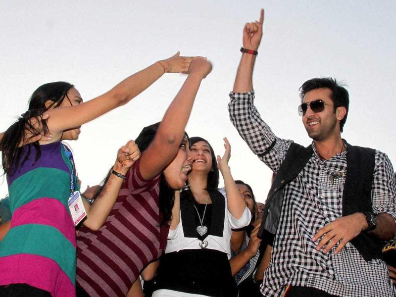 Fans of the Bollywood actor try to shake hands with him during a promotional event.